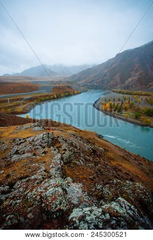 River In The Mountains In Cloudy Weather. Place Of The Confluence Of The Rivers Katun And Chuya In A
