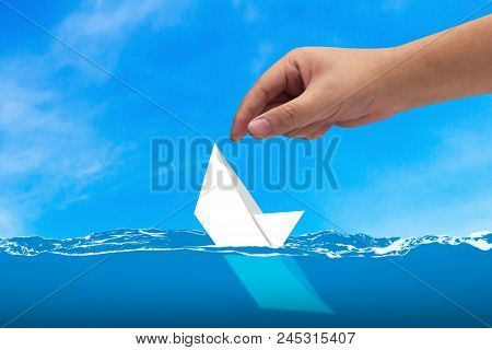 Business Solution, Solving Problem, Strategy And Planning Concept, Hand Rescue Sinking Paper Boat