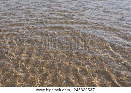 Clear Sea Water. Beautiful Sun Reflections On Sea Water. Sun Light And Clear Sea Water Texture Backg