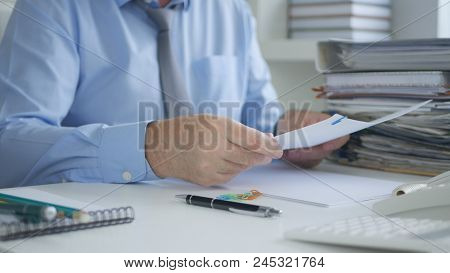 Businessperson Image Reading Accounting Documents And Invoices