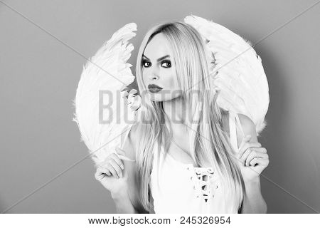 Angelic Beauty. Angel. Portrait Of Beautiful Blonde Woman With Angel Wings, Angel With Long Hair And