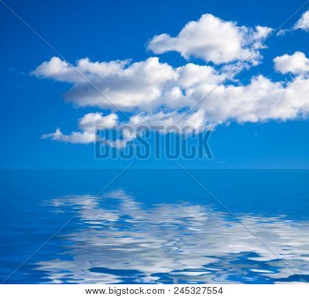 Beautiful blue sea and white clouds sky