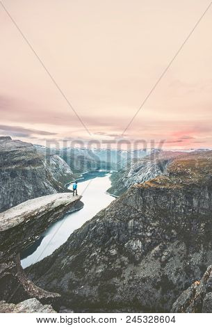 Traveler Man On The Edge Of Trolltunga Cliff  Traveling In Norway Adventure Lifestyle Extreme Vacati