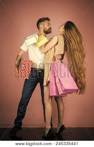 Shopping And Sale. Fashion Shopaholic Couple. Black Friday, Happy Holiday, Relations. Girl And Beard