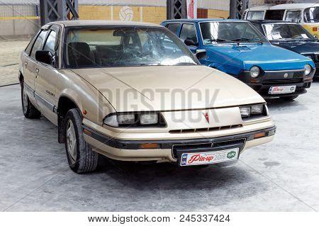 Kharkiv, Ukraine - May 19, 2018: Retro Car Pontiac Grand Prix Manufactured In 1992 Is Presented At T