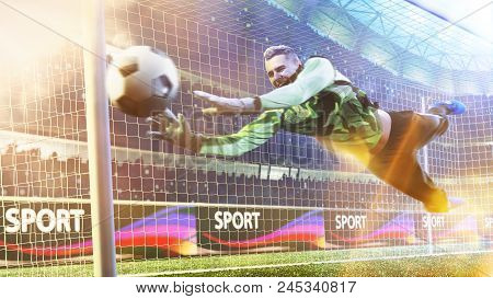 Goalkeeper Catches The Ball In The Football Stadium