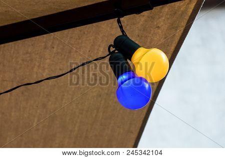 Background Series : Colorful Light Bulbs . Bulb Light Blue Yellow