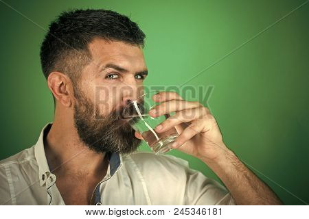 Water Pledge Is Healthy. Hangover And Thirst. Man With Long Beard Hold Water Glass On Green Backgrou