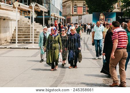 Istanbul, June 15, 2017: Local Residents Go About Their Business On The City Street. Women With Shop