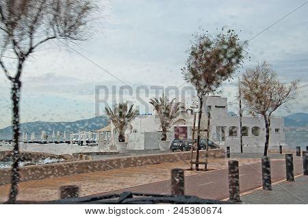 Palma De Mallorca, Spain - November 15, 2011: Puro Beach Seen Through Raindrops On Car Window In Pal