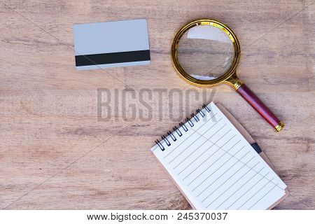 Credit Card ,magnify And Book Note ,concept Business Monitor