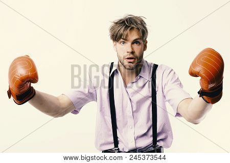 Man With Bristle And Scared Face Wears Boxing Gloves. Nerd With Leather Box Equipment Isolated On Wh
