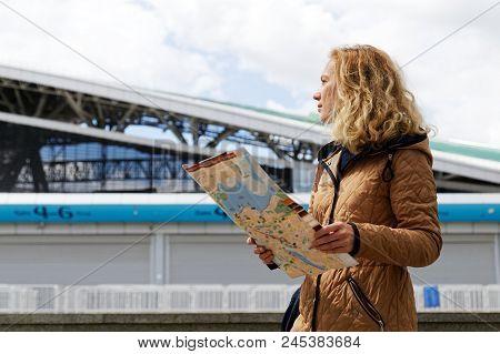Woman Tourist Holding A Tourist Map Of Kazan.