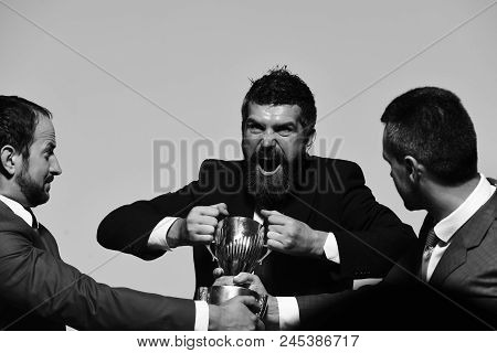 Businessmen With Mad Faces In Formal Suits On Grey Background. Coworkers Or Partners Fight For Winni