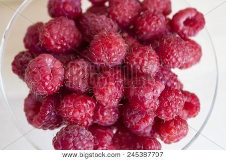 Fresh And Sweet Red Raspberries Texture Background. Raspberry Fruit Pile Background. Selection Of Fr