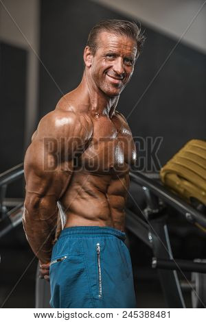Brutal Aged Strong Bodybuilder Athletic Men Pumping Up Muscles With Dumbbells