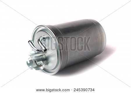 A New Fuel Filter Enclosed In A Metal Casing With An Inlet And Outlet On Fuel Lines On A White Isola