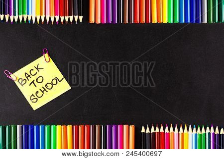 Back To School Background With A Lot Of Colorful Felt-tip Pens And Colorful Pencils, Titles Back To