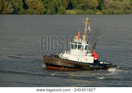 Tugboat Of Red And White Color In The River.