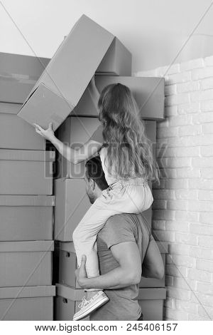 New Home, Moving In And Family Concept. Girl And Man In Room On White Brick Wall Background. Daughte