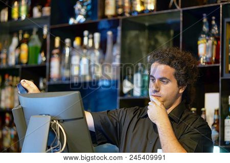 Registration Male Of Bartender Employee Of A New Order By A Cash Register. The Barman Pays The Order
