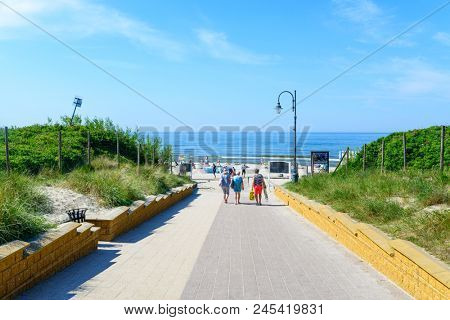 KRYNICA MORSKA - MAY 28: Tourists enjoy the sunny weather are going to the beach on 28 May 2018 in Krynica Morska, Poland.