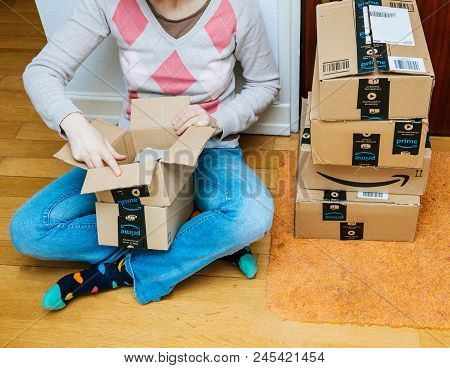 Paris, France - Jan 13, 2018: Woman Unboxing Amazon Prime Packages Delivered To A Home Door Stack Of