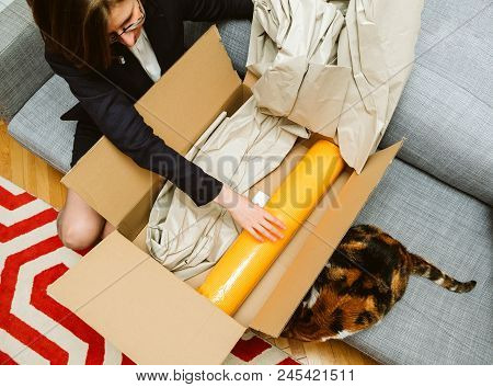 Business Woman Unpacking Unboxing Cardboard Box Box Containing Yellow Yoga Zen Mat Being Helped By H