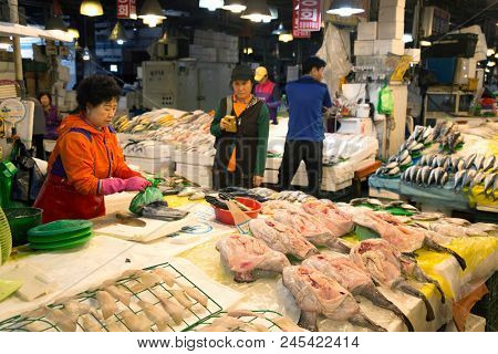 SEOUL-SOUTH KOREA, MAY 18, 2018:  Woman at her stand at the fish market in south Korea.  Noryangjin Fish Market is an extensive farmers fish market in the neighborhood of Noryangjin-dong