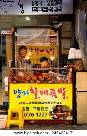 SEOUL-SOUTH KOREA, MAY 17, 2018: Woman selling food in a food stand in Namdaemun Market in South Korea, the oldest and largest market in Korea