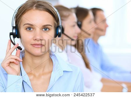 Call Center Operator In Headset While Consulting Client. Telemarketing Or Phone Sales.