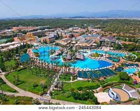 Side, Turkey - June 9, 2018: Aerial view of the tropical resort Pegasos World in Side, Turkey. Pegasos World Hotel is a 4-star resort with 9600 square metres of pool areas.