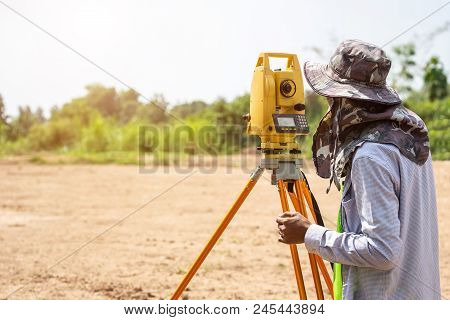Surveyor Engineer Making Measure At The Land