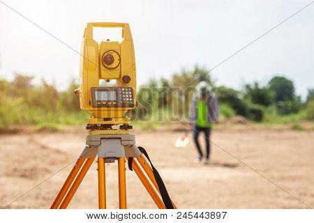 Surveyor Engineer Making Measure At The Land