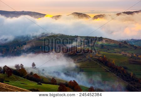 Cloud Inversion In Autumn Mountains At Dawn. Beautiful Nature Scenery. Fog Rolling Above The Rural F