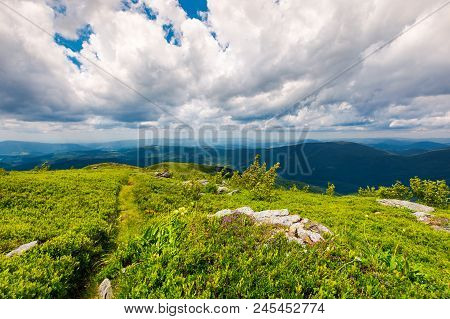 Path Along The Grassy Slope On Top Of A Mountain. Lovely Summer Landscape. Wonderful Place For Hikin