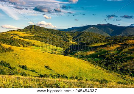 Grassy Hillsides In High Mountains In Afternoon. Beautiful Summer Landscape With Borzhava Mountain R