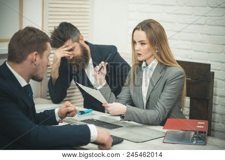 Office Atmosphere Concept. Lady Manager Tries To Organize Working Process With Colleagues In Office.