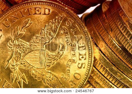 American gold coins on dark background