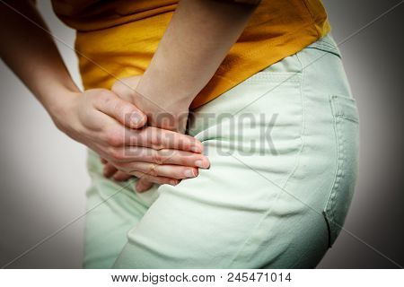 Part Of Body Young Sick Woman With Hands Holding Pressing Her Crotch Lower Abdomen. Medical Or Gynec