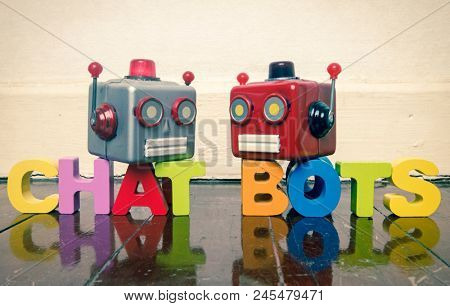 two talking heads with the word CHAT BOTS on a wooden floor with reflection