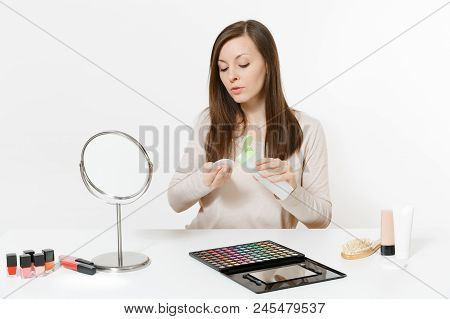 Woman Applies Make-up Remover For Facial Sponge, Wipes Her Skin Face, Sits At Table Applying Makeup