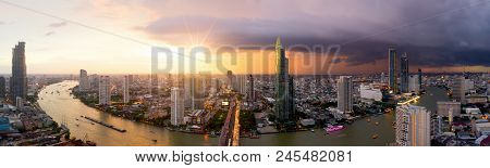 Aerial view of Bangkok modern office buildings, condominium, living place in Bangkok city downtown with sunset scenery, Bangkok is the most populated city in Southeast Asia.Bangkok , Thailand poster