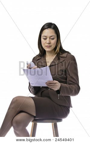 Female Holding Phone And Sheet Of Paper