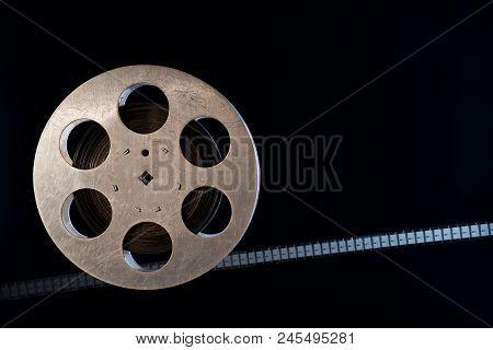 Movie Old Film 35mm Reel On Dark Background
