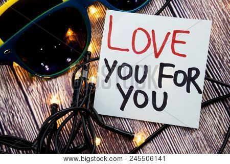 Love You For You Handwritten On White Note Paper And Love Written In Red Color And Further Written I