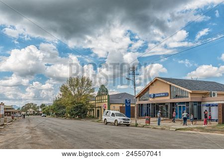 Zastron, South Africa - April 1, 2018: A Street Scene, With A Bank, Bar, Vehicles And People, In Zas