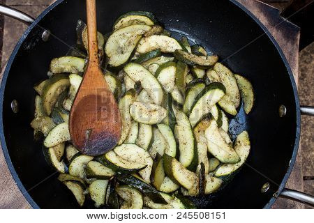 Vegetarian Food Fried In Frying Pan. Sliced Courgette And Prepared In Hot Oil. Delicious Vegetables