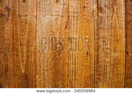 Brown Wooden Background . Empty Wooden Board Background. Brown Scratched Wooden Cutting Board. Wood