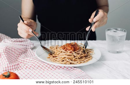 Young Attractive Beautiful Girl Woman Eating Italian Food A Plate Of Pasta With Sugo, Lifestyle. Ita